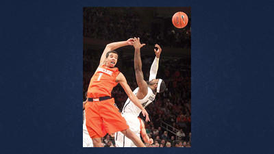 Syracuse's Michael Carter-Williams, left, and Pittsburgh's J.J. Moore fight for a rebound during the first half of an NCAA college basketball game at the Big East Conference tournament Thursday in New York.