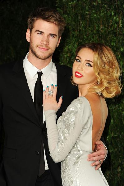 "Whether Miley Cyrus and Liam Hemsworth have split up has been the topic of much rumor for the last week or so — with the talk hitting a fever pitch Wednesday morning as a report citing ""multiple sources"" pronounced, ""It's over."" But hours later, another outlet said not so fast. Wednesday afternoon, E! News joined the fray with a hold-on-a-minute report declaring that the two ""have been a bit rocky, but are not giving up.""