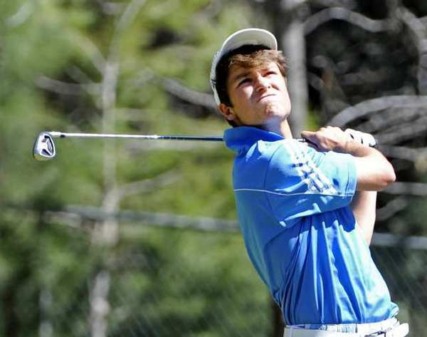 Burbank's Roman Verciglio tees off on the third tee in a Pacific League golf match with Burbank, Crescenta Valley, Glendale, Burroughs, and Arcadia at the De Bell Golf Course in Burbank on Thursday, March 14, 2013. (Tim Berger/Staff Photographer)