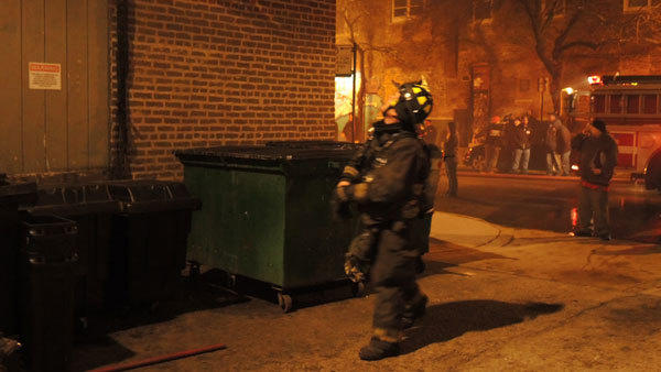 A firefighter approaches the basement of Lillie's Q barbecue restaurant in th