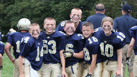 In this photo from Change.org, Caroline Pla, far right, is pictured with her teammates in the Catholic Youth Organization's football league. A ruling Thursday reversed the league's policy and will allow Caroline to play again next season.
