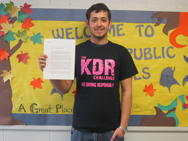 Alanson senior Paul Klutts poses with the petition he started at Alanson on www.change.org to encourage lawmakers to pass Senate Bill 756 regarding Level 1 and Level 2 drivers use of cell phones..