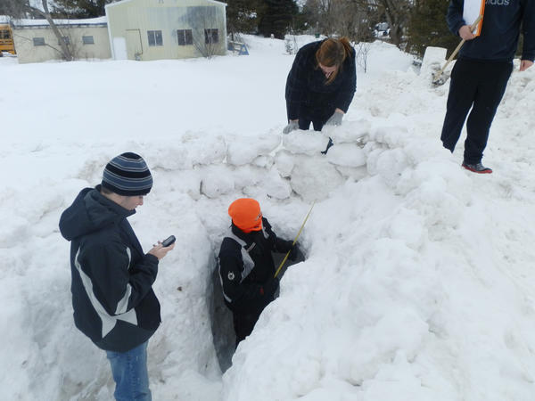 Courtesy photo.Alanson High School students Jacob Scheider (foreground), Max Oom (in tunnel), and Sabrina Wolfgang, all members of Caitlin Fowlers Math 12 class, work on snow forts using their mathematics calculations..