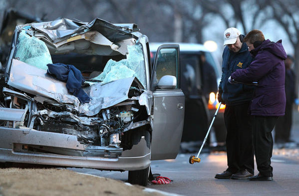 Police investigate the scene of a three-car accident on southbound Lake Shore Drive.