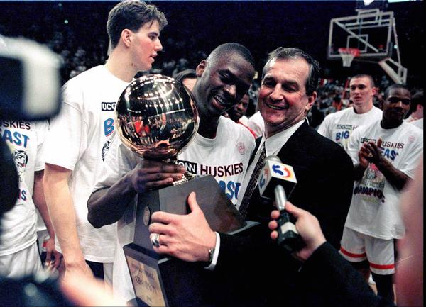 Uconn Vs Georgetown 3/9/96 Ucon's coach Jim Calhoun and #23 Rudy Johnson celebrate the Big East win tonight at Madison Square Garden in NYC.  Photo by TonyBacewicz/Staff    3/10/96 E4 ORG XMIT:..UConn men's team