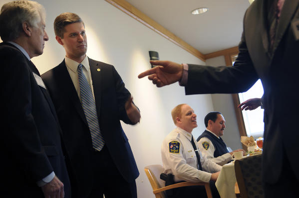 West Hartford Mayor Scott Slifka (second from left) says hello to visitor while talking with his father Robert Slifka at the University of Hartford before delivering his 2012 State of the Town address.