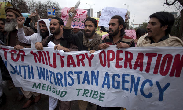 Pakistani tribal people from South Waziristan hold a rally in Islamabad to condemn U.S. drone attacks and military operations against Taliban and Al Qaeda militants.