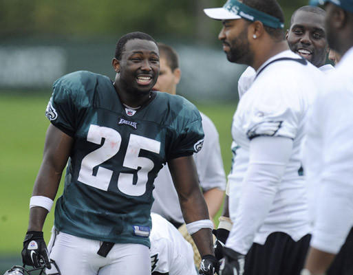 LeSean McCoy talks with teammates at Eagles practice at Lehigh Thursday.