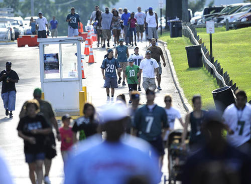 Eagles fans march to the practise fields to watch their team early Saturday.