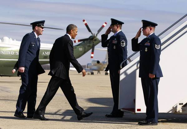 President Barack Obama prepares to board Air Force One at Andrews Air Force base near Washington. Obama is traveling to Chicago for an event at Argonne National Laboratory in Lemont, Ill., where he will propose diverting $2 billion in revenue from federal oil and gas leases to pay for research on advanced vehicles.