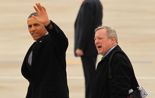 President Barack Obama, U.S. Senator Dick Durbin and Energy Secretary Steven Chu arrive on Air Force One at O'Hare International Airport today.