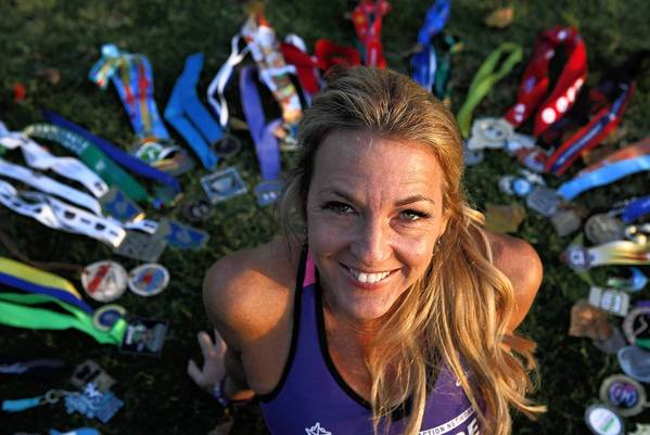 Julie Weiss has racked up many medals over her year of marathons.