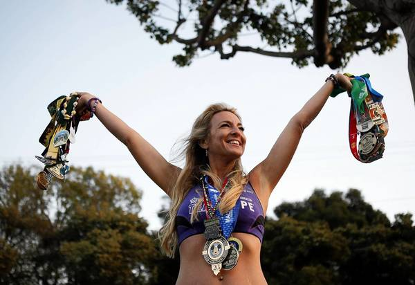 Marathon runner Julie Weiss displays her medals.