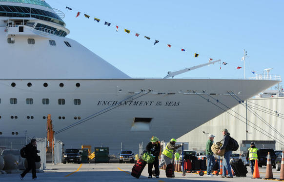 Vacationers leave the Maryland Cruise Ship Terminal after disembarking from Enchantment of the Seas.