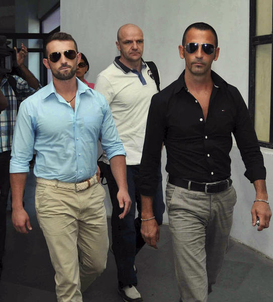 Italian marines Salvatore Girone, left, and Massimiliano Latorre, right, arrive at a police commissioner's office in Kochi, India, in this Dec. 20, 2012, file photo.