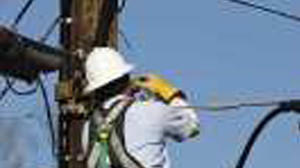 Inter-County checking utility poles in Lincoln County