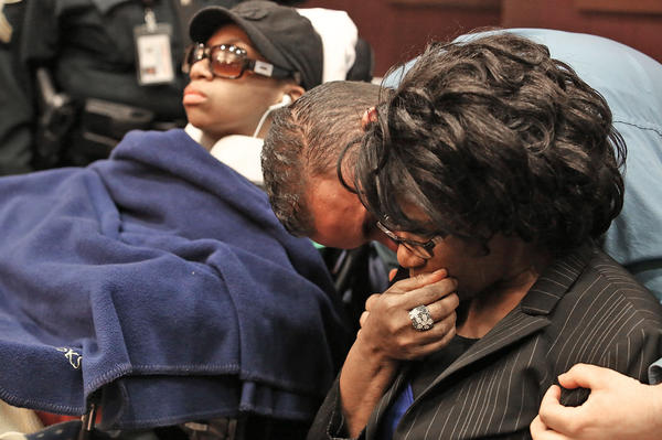Alma Fletcher,right,mother of Danielle Sampson,left, is comforted by Hector Torres,victims advocate after Tyrone Mosby was found guilty in Danielle Sampson shooting.