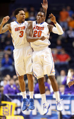 Mike Rosario #3 and Michael Frazier II #20 of the Florida Gators celebrate after Frazier II made a three point basket to end the first half against the LSU Tigers during the Quarterfinals of the SEC basketball tournament at Bridgestone Arena