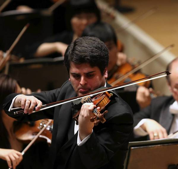 Violin soloist Michael Barenboim performs with the Chicago Symphony Orchestra at Symphony Center on Thursday.