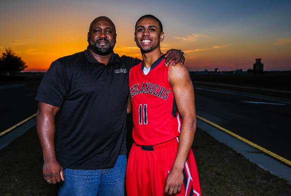 Lake Highland junior guard Joel Berry, shown with his father Joel, missed part of this past season with a knee injury. His father's promising career was ended by a knee injury. (Joshua C. Cruey, Orlando Sentinel)