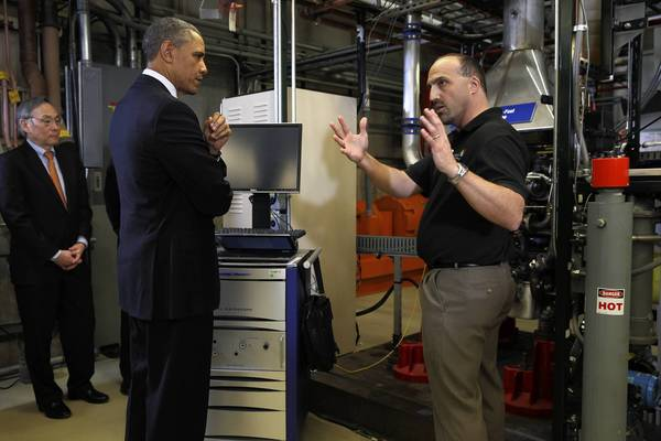President Obama listens to Dr. Steve Ciatti, engine combustion specialist, during a visit to Argonne National Laboratory's Advanced Powertrain Research Facility.