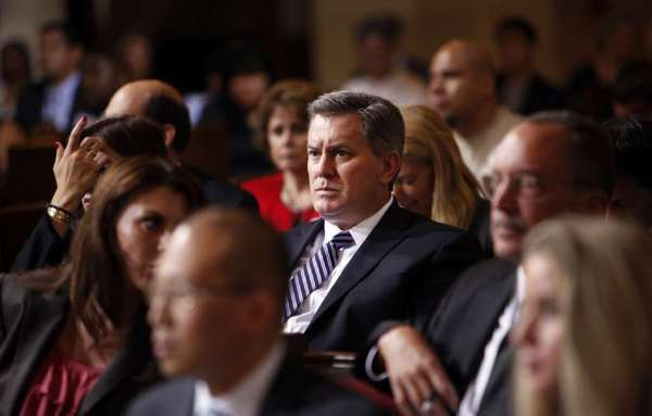 Former AEG Chief Executive Tim Leiweke, pictured above at a City Council committee meeting last September on the proposed Farmers Field in downtown L.A., parted ways with the company after it was taken off the market.