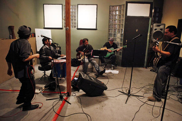 "Members of the L.A. Chicano band Ollin rehearse for a St. Patrick's Day gig playing the music of their Anglo Irish brothers in song the Pogues. Ollin will cover the Pogues' ""Rum, Sodomy and the Lash"" Sunday at the Satellite in Silver Lake."