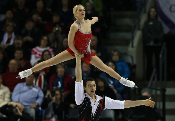 Chris Knierim lifts Alexa Scimeca in Friday's pairs free skate at the World Championships. (Dave Sanford / Getty Images)