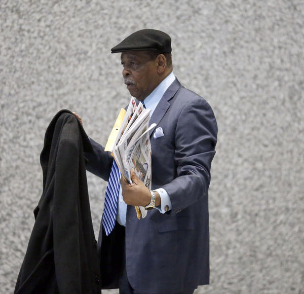 Longtime politician William Beavers, hold a stack of newspapers, arrives at the Dirksen Federal Courthouse in Chicago on Tuesday, March 12, 2013.