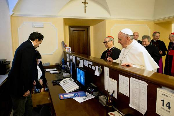 Pope Francis pays his own bill at the Rome residence where he stayed during the conclave of cardinals.