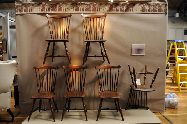 "A set of six matching tulip poplar and ash fanback Windsor chairs, each branded on the underside of the seat ""E. Tracy"" for the shop of Elisha Tracy of Lisbon, Conn., c. 1795-1805, are on display at the 40th Spring Antiques Show at the Hartford Armory. Price: $32,500.00. The show runs Saturday and Sunday."
