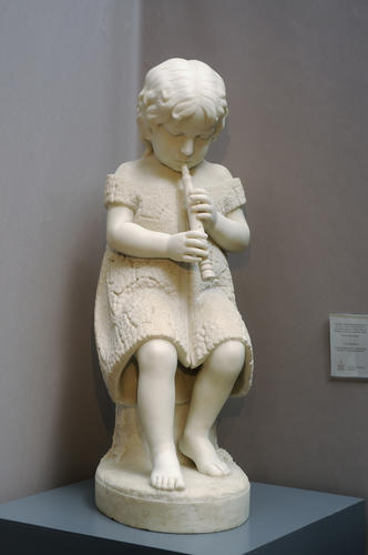 "A white marble sculpture called ""The Piper"" by C.B. Ives, from the mid-19th century, is on display at the 40th Spring Antiques Show at the Hartford Armory."