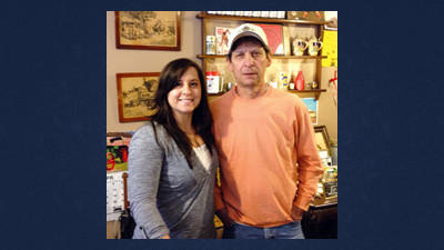 Jimmy Lishia poses here with his daughter, Mandy, in his antique shop during an interview last April. Mandy plans to continue her father's businesses and will have the antique shop open for maple festival.