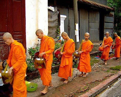 """Monks in Luang Prabang, Laos, gather sticky rice donations from villagers.<br> <br> <b>Read about Laos:</b><br> • <a href=""""http://www.latimes.com/travel/la-trw-2009spots-pg,0,6708727.photogallery?index=6"""">29 destinations to visit in 2009</a><br>"""