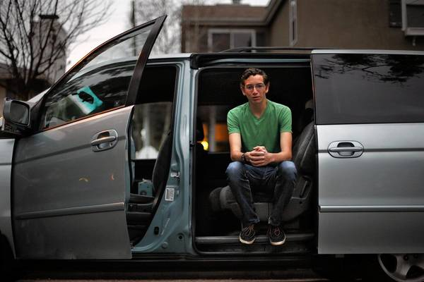 "Christian Kerr, 16, of Long Beach, with his family's Honda Odyssey, is one of a growing number of teenagers who are in no hurry to learn to drive. ""Getting a license just isn't a priority,"" he says."