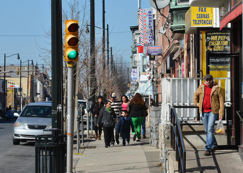 People walk on 7th street in downtown Allentown on a sunny afternoon.