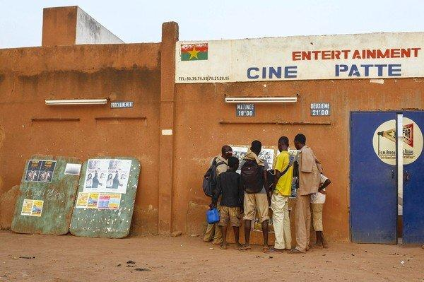School boys look at film posters outside the open air Cinema Patte Doie during the Panafrican Film and Television Festival in Ouagadougou, Burkina Faso.
