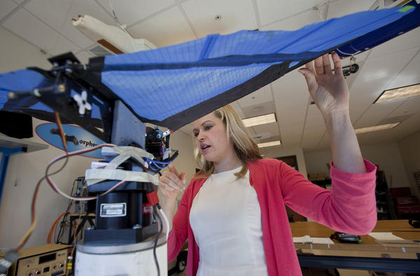 Cornelia Altenbuchner, a University of Maryland graduate student, explains how a ornithopter functions at the Morpheus Lab in the National Institute of Aerospace. The flapping wing vehicle is constructed from carbon fiber and Ripstop material. Altenbuchner hopes the small aircraft will eventually be used by law enforcement and firefighters to gather surveillance information from hazardous scenes.