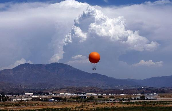 A balloon lifts visitors above the Orange County Great Park.