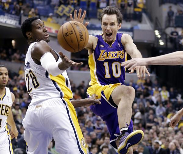 Lakers guard Steve Nash, right, loses the ball while attempting to shoot over Indiana Pacers center Ian Mahinmi.
