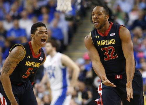 Terps guard-forward Dez Wells, right, celebrates with teammate Nick Faust after making a shot in the first half of the ACC quarterfinal game at Greensboro Coliseum.