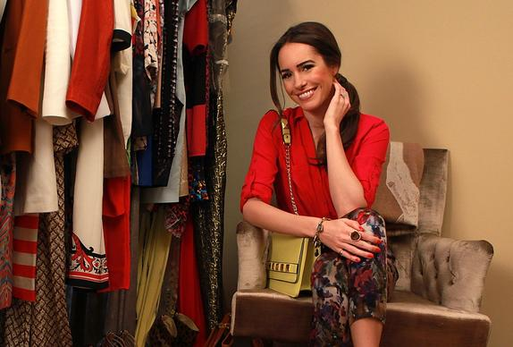 Television personality Louise Roe shows off her extensive wardrobe and accessories at her home in West Hollywood.