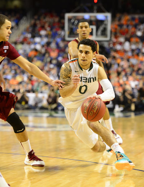 Shane Larkin scored 20 points and Kenny Kadji chipped in 15 with 11 rebounds, as ninth-ranked Miami-Florida fought off a stiff challenge from Boston College and claimed a 69-58 victory in the ACC Tournament quarterfinals.  Trey McKinney Jones added 12 points for the Hurricanes (25-6), who closed the contest with a 14-3 run. Miami captured the top seed in the tournament for the first time after winning the regular-season crown outright and will next faced fifth-seeded North Carolina State in Saturday's semifinals.