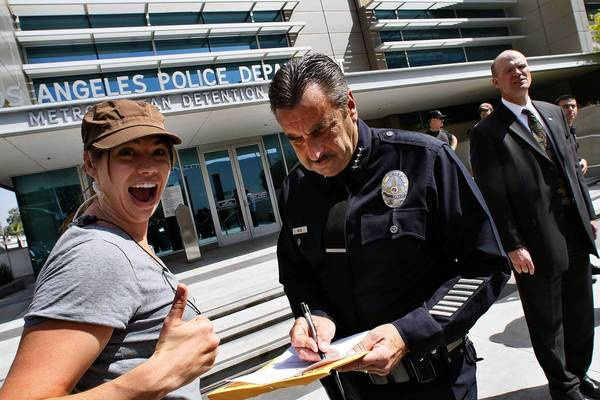 "Katey Wheelhouse, left, second assistant diector of the TNT police drama ""Southland,"" is shown with LAPD Chief Charlie Beck during filming of the show's season finale in front of Parker Center in Los Angeles."
