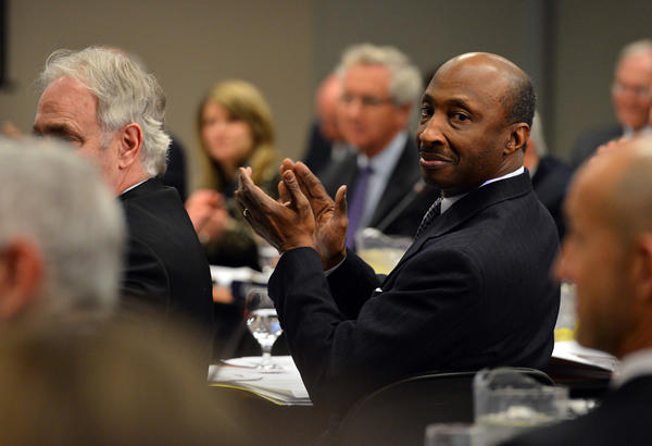Ken Frazier, center, member of the Penn State Board of Trustees responds during a Penn State Board of Trustees meeting held at Penn State Milton S. Hershey Medical Center on Friday.