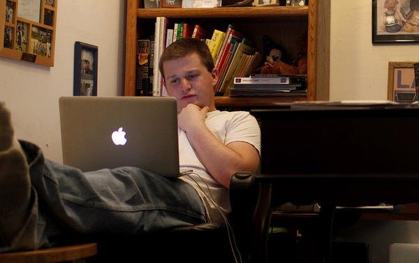 A Pierce College student works on homework at his family's home in Tarzana. He is enrolled in an online English class.