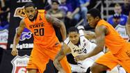 Kansas State's McGruder, Oklahoma State's Cobbins and Gardner scramble for loose ball during NCAA men's Big 12 tournament in Kansas City