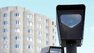 Federal authorities have launched a criminal probe of bribery allegations in Chicago's red-light camera program, issuing a subpoena for financial records of the former city official at the center of the escalating international scandal.