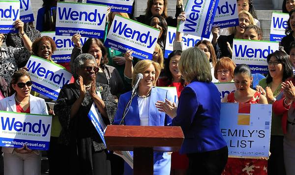 Wendy Greuel, center, is joined by EMILY's List President Stephanie Schriock, center right, on Friday during a City Hall news conference at which the city controller accepted the group's endorsement for mayor.