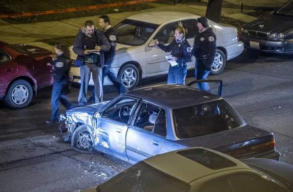 A male gunman opened fire on police officers as they approached his vehicle after driving erratically and crashing into several parked cars early Saturday morning. The gunman was shot and killed by police at 3317 W. Wilson Ave. in Chicago.